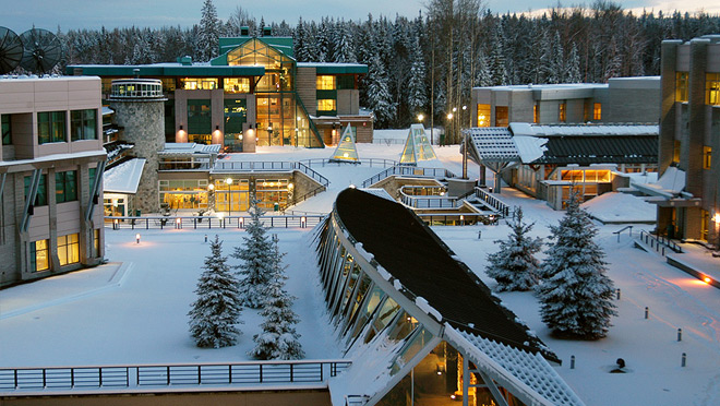 Snowy UNBC campus as night falls