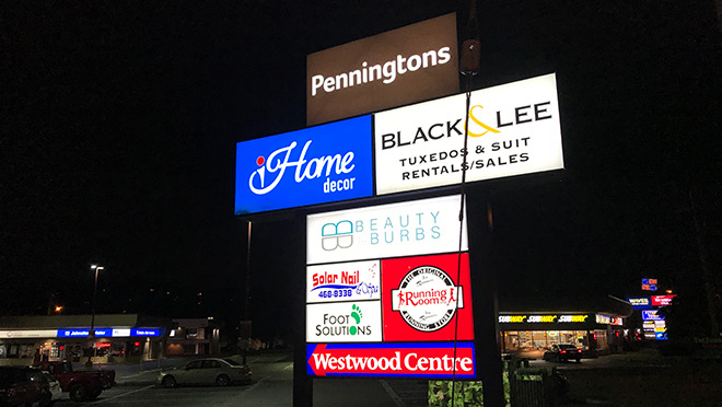 Image of illuminated signs at Westwood Centre