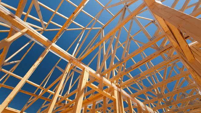 Image of wood-framed house under construction