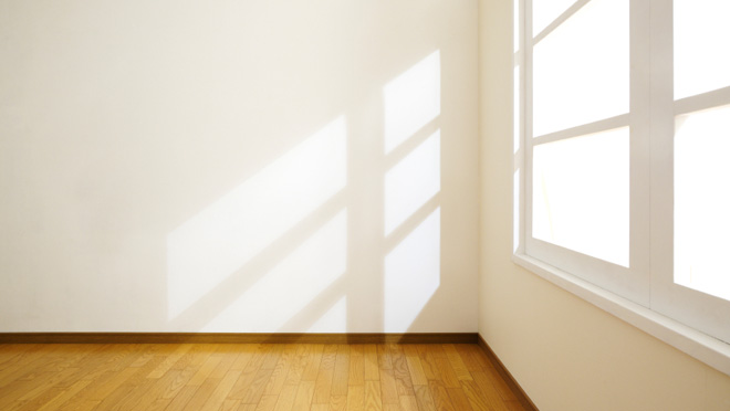 Image of bright sunlight shining into empty office space