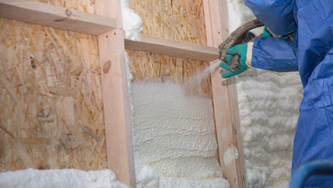 Image of a contractor installing blown insulation