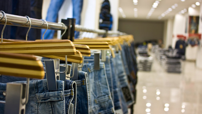 Image of jeans hanging on a clothing shop rack