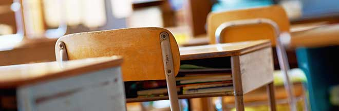 Desks in an elementary school classroom