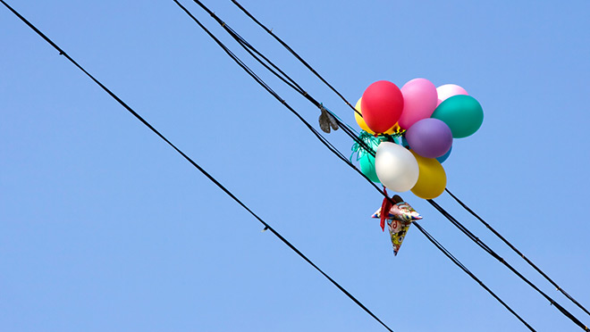Image of balloons caught on electrical wires