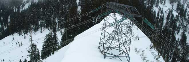 Image of snow-capped peak and transmission tower, Interior to Lower Mainland Transmission Project