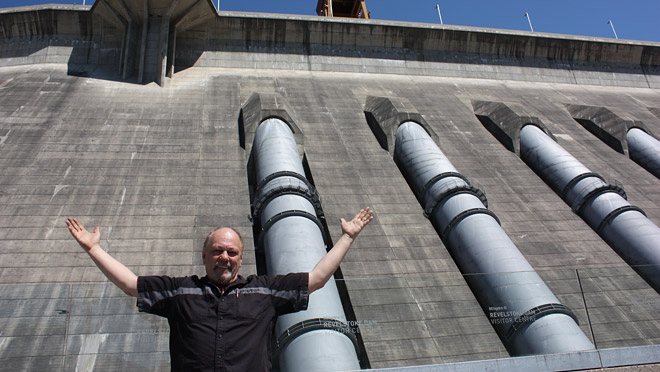 Vernon's Derrick Hiebert poses in front of Revelstoke penstocks after visiting the Dam Visitor Centre.