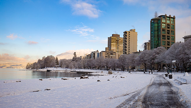 Image of Vancouver's English Bay beach covered in winter snow