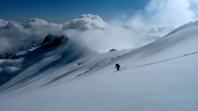 Skier makes fresh tracks during heli-skiing in the Revelstoke area.