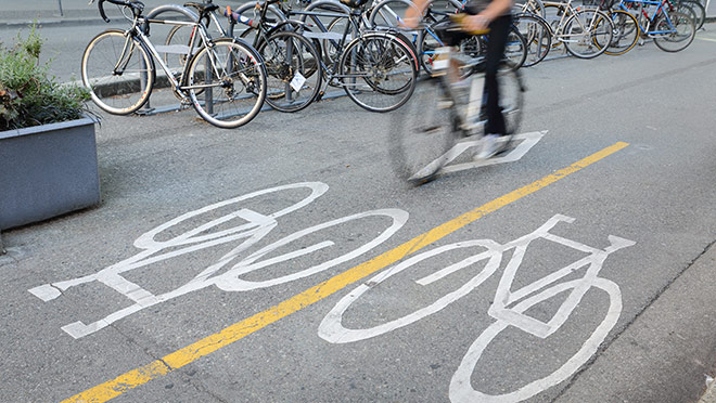 Image of a cyclist riding on a downtown Vancouver bike lane
