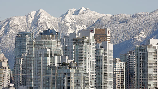 downtown Vancouver skyline set against snowy North Shore backdrop