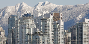 Vancouver buildings with snowy mountains
