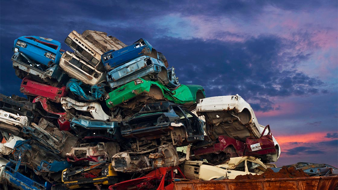 Cars piled up in scrapyard