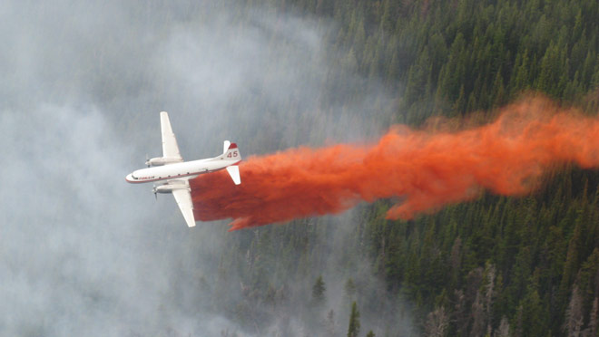 Conair water bomber drop onto forest fire