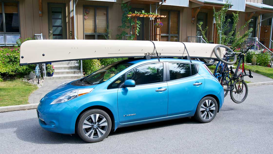 Nissan Leaf loaded with canoe, bikes