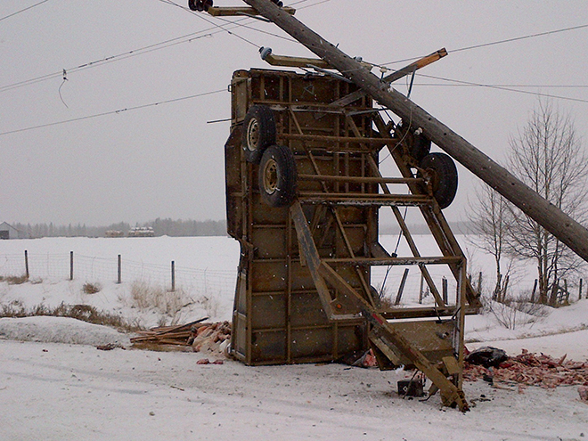 Car accident in the snow involving power pole