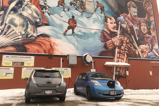 Two Nissan Leafs plugged in at Trail arena
