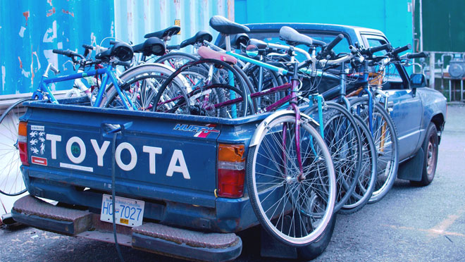 Image of pickup truck with bikes for PEDAL society