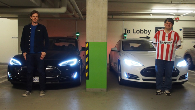 Image of Daryl Gates and Kevin Perry of Electronics Arts Canada with two Telsa Model S electric vehicles