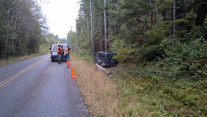 Image of a van that has hit a power pole near Ucluelet