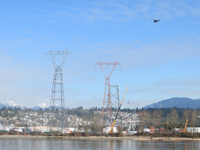 Contruction of transmission lines over Fraser River with helicopter