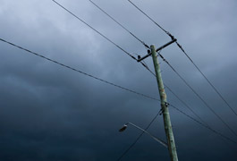 Why are power lines louder in the rain?